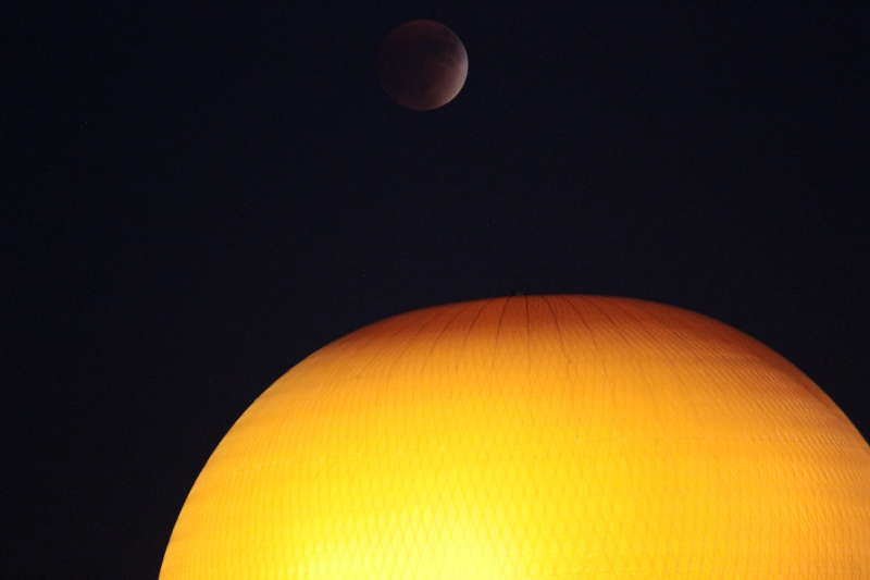 Eclipsed moon over the Great Park balloon ride